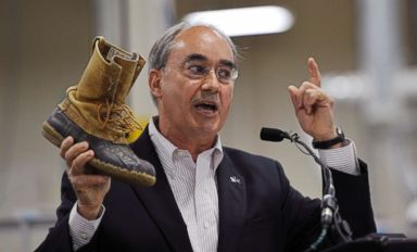 PHOTO: Rep. Bruce Poliquin shows of his thirty-year-old L.L. Bean boots during an event at the new production plant in Lewiston, Maine, August 17, 2017.