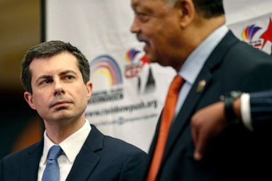 PHOTO:Democratic presidential candidate and South Bend, Ind., Mayor Pete Buttigieg, left, listens as Rev. Jesse Jackson addresses reporters during a news conference at the Rainbow PUSH Coalition Annual International Convention in Chicago, July 2, 2019.