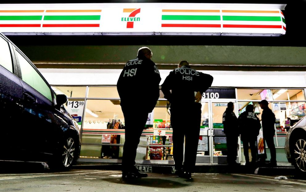 PHOTO: Immigration and Customs Enforcement agents serve an employment audit notice at a 7-Eleven convenience store in Los Angeles, Jan. 10, 2018.