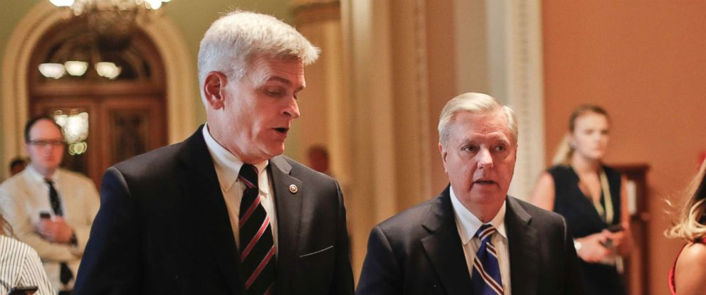 PHOTO: Sen. Bill Cassidy, R-La., left, and Sen. Lindsey Graham, R-S.C., right, talk while walking to a meeting on Capitol Hill, July 13, 2017.