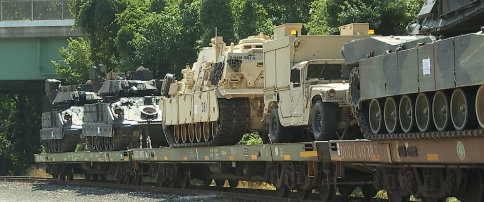 PHOTO: Two M1 Abrams tanks and two Bradley Fighting Vehicles transported to Washington DC for July 4 festivities are seen at a rail head in Washington D.C.