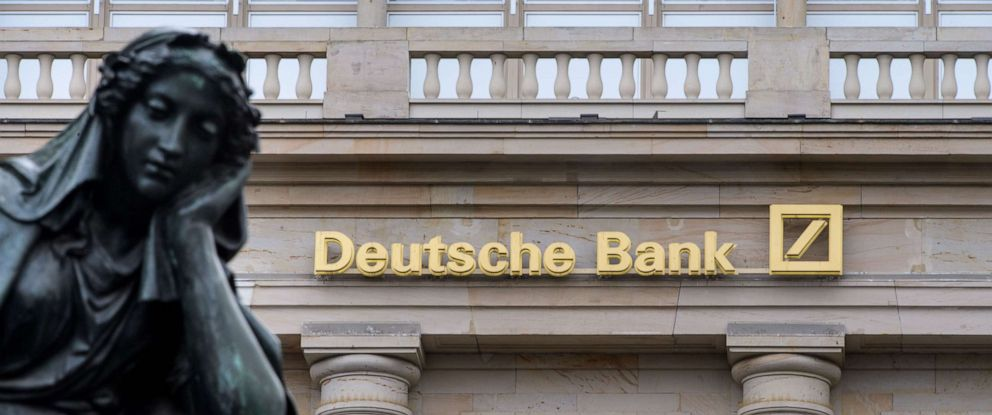 PHOTO: A branch of the German bank Deutsche Bank pictured with a sculpture of the Gutenberg monument, Feb. 1, 2018, in Frankfurt, Germany.