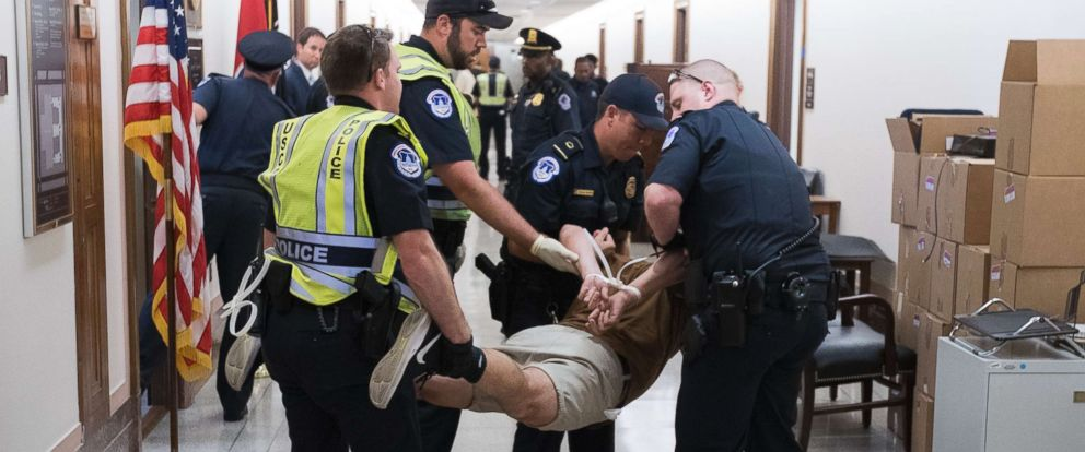 PHOTO: Tim Murphy, center, an HIV-positive man from New York, is arrested outside the office of Republican Senator Lamar Alexander while protesting the Republican-crafted health care bill in Washington, July 10, 2017.