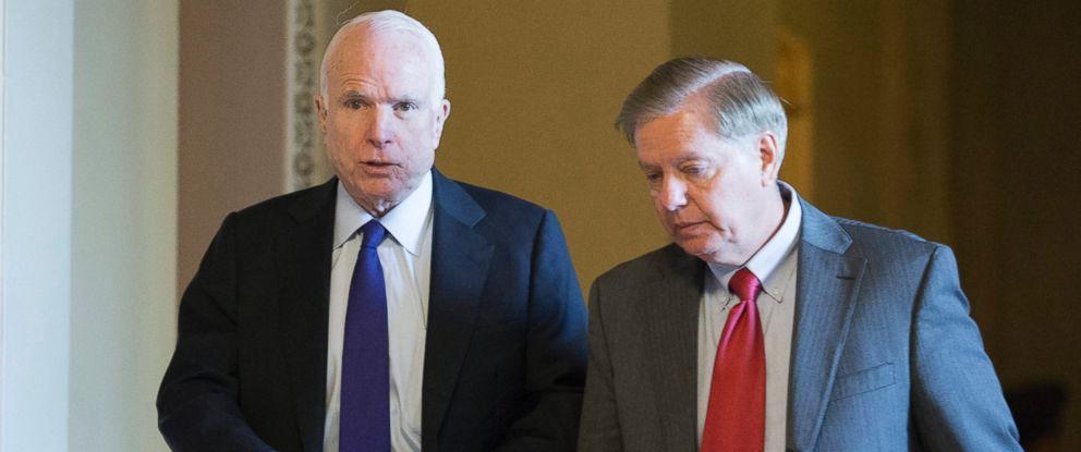 PHOTO: Sen. John McCain (L) and Sen. Lindsey Graham (R) walk near the Senate chamber following Senate Republican elections on Capitol Hill in Washington, Nov. 16, 2016.