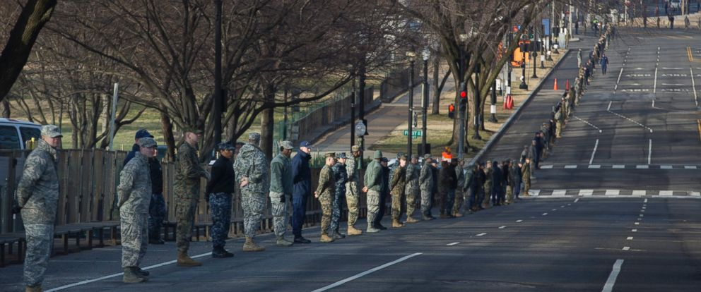 PHOTO: Security forces stand along the parade route on Constitution Avenue, during a dress rehearsal for the 58th Presidential Inauguration at the Capitol in Washington, Jan. 15, 2017.
