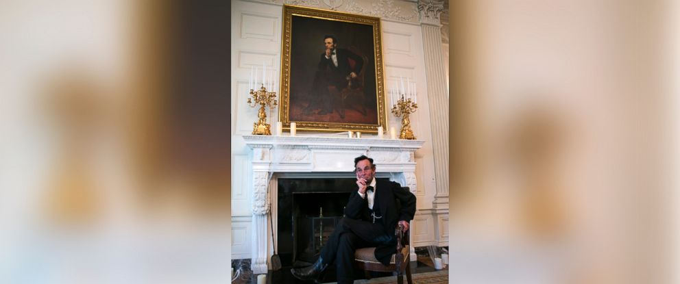 PHOTO:Actor Fritz Klein dressed as US President Abraham Lincoln during a Halloween White House tour in the state dining room of the White House in Washington DC, October 28,2016.