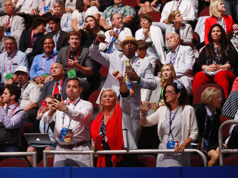 PHOTO:Alternates and guests react as Texas Senator and former Republican presidential hopeful Ted Cruz speaks during the third day of the 2016 Republican National Convention at Quicken Loans Arena in Cleveland, July 20, 2016.