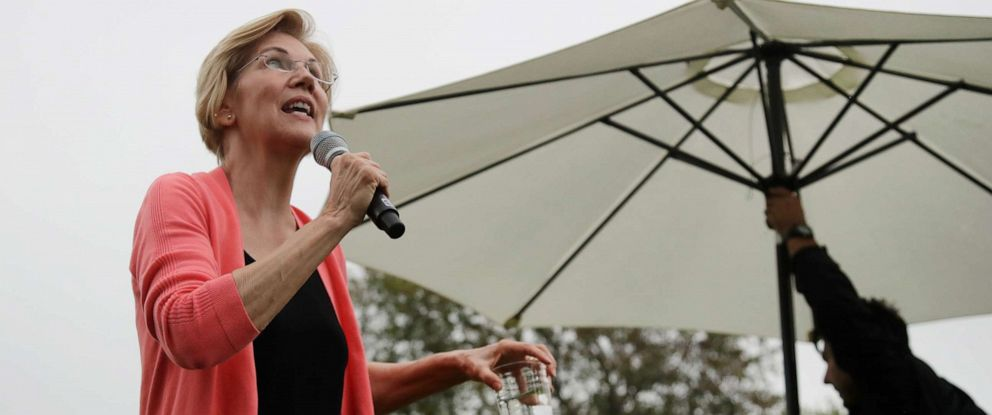 PHOTO: Democratic presidential candidate Sen. Elizabeth Warren, D-Mass., looks up at the rain as an umbrella is set up during a campaign event, Monday, Sept. 2, 2019, in Hampton Falls, N.H.