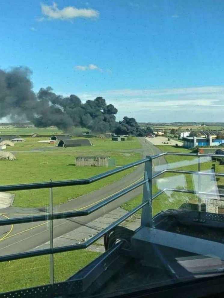 PHOTO: A cloud of smoke at Florennes Air Base in Belgium after the Belgian Air Force F-16 was accidentally struck by cannon fire by another F-16 on the tarmac.