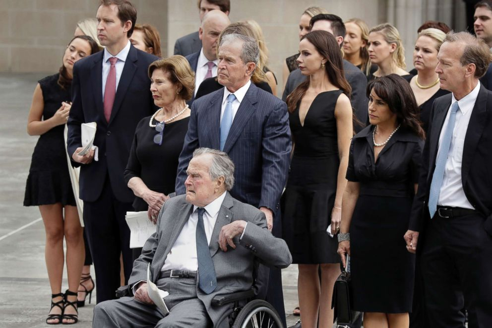 PHOTO: Former Presidents George H.W. Bush and George W. Bush accompanied by family members watch as pallbearers carry the casket of former first lady Barbara Bush following a funeral service at St. Martins Episcopal Church, April 21, 2018, in Houston.