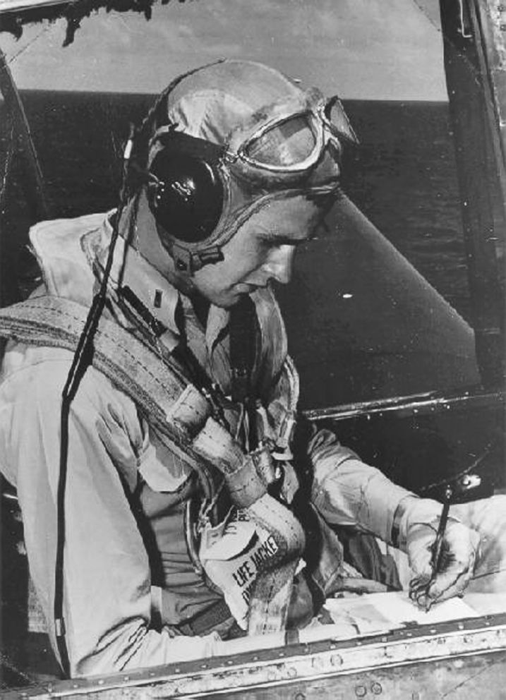 U.S. Navy pilot George Bush sits in the cockpit of an Avenger fighter aircraft, circa 1943-45.