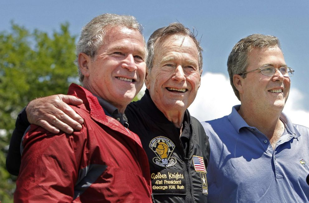 PHOTO: Former President George H. W. Bush poses with his sons, former President George W. Bush and Jeb Bush after completing a parachute jump in Kennebunkport, June 12, 2009 for his 85th birthday.