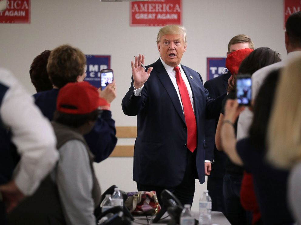 PHOTO: Republican presidential nominee Donald Trump talks with volunteers at a campaign phone bank before a rally at the Bank of Colorado Arena on the campus of University of Northern Colorado, Oct. 30, 2016 in Greeley, Colorado.