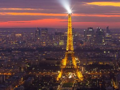 PHOTO: The Eiffel tower shining its spotlight just after sunset, March 16, 2014, in Paris.