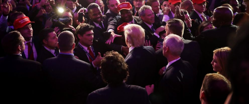 PHOTO: Republican president-elect Donald Trump greets supporters in the crowd after delivering his acceptance speech at the New York Hilton Midtown in the early morning hours of Nov. 9, 2016 in New York City.