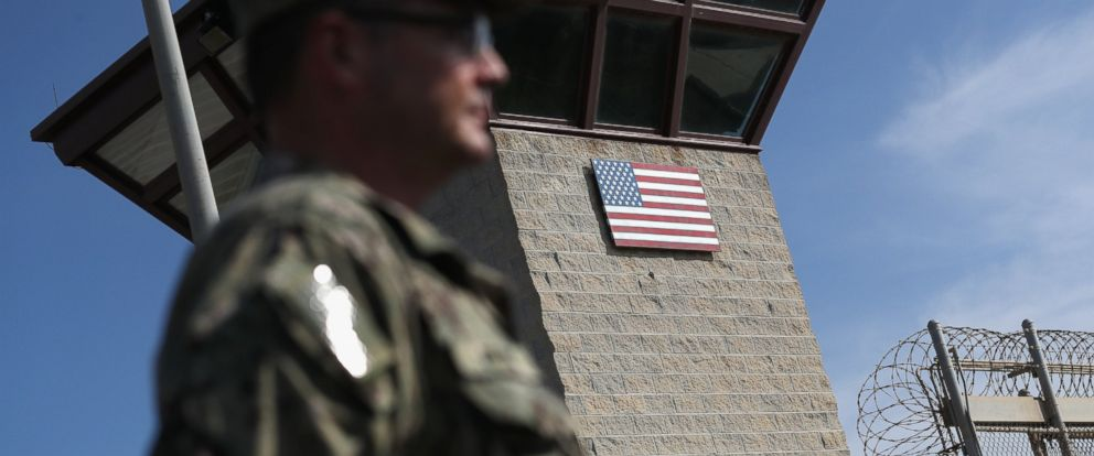"""PHOTO: A U.S. Naval officer stands at the entrance of the U.S. prison at Guantanamo Bay, also known as """"Gitmo,"""" on Oct. 22, 2016, at the U.S. Naval Station at Guantanamo Bay, Cuba."""