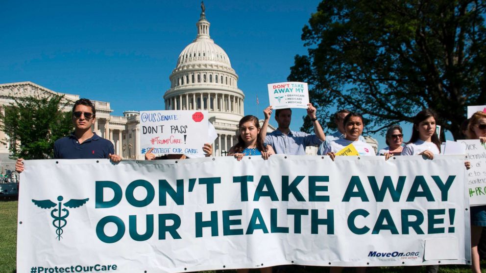 Protesters against the US Senate Republicans' healthcare bill hold a rally outside the US Capitol in Washington, DC, June 28, 2017.