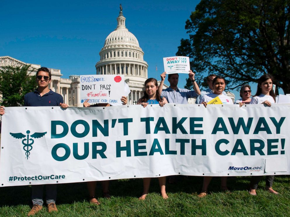 PHOTO: Protesters against the US Senate Republicans healthcare bill hold a rally outside the US Capitol in Washington, DC, June 28, 2017.
