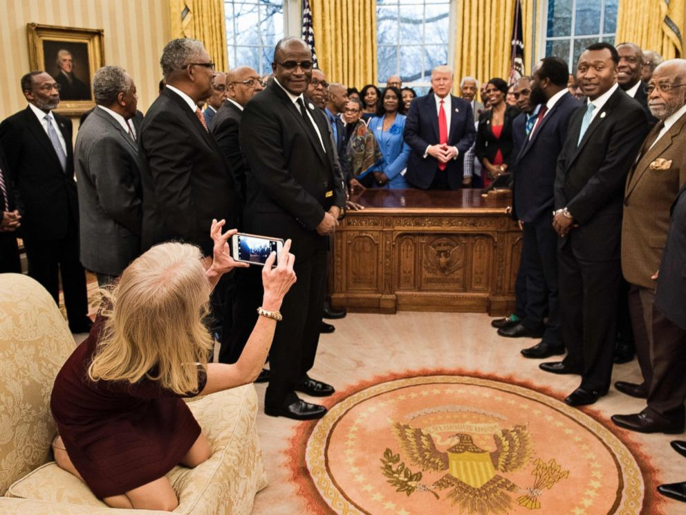 PHOTO: Counselor to the President, Kellyanne Conway, takes a photo as U.S. President Donald Trump and leaders of historically black universities and colleges talk before a group photo in the Oval Office of the White House, Feb. 27, 2017, in Washington.