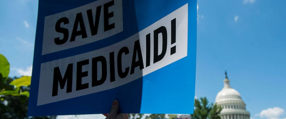 PHOTO: Participants hold signs during the Senate Democrats rally against Medicaid cuts in front of the U.S. Capitol on June 6, 2017.