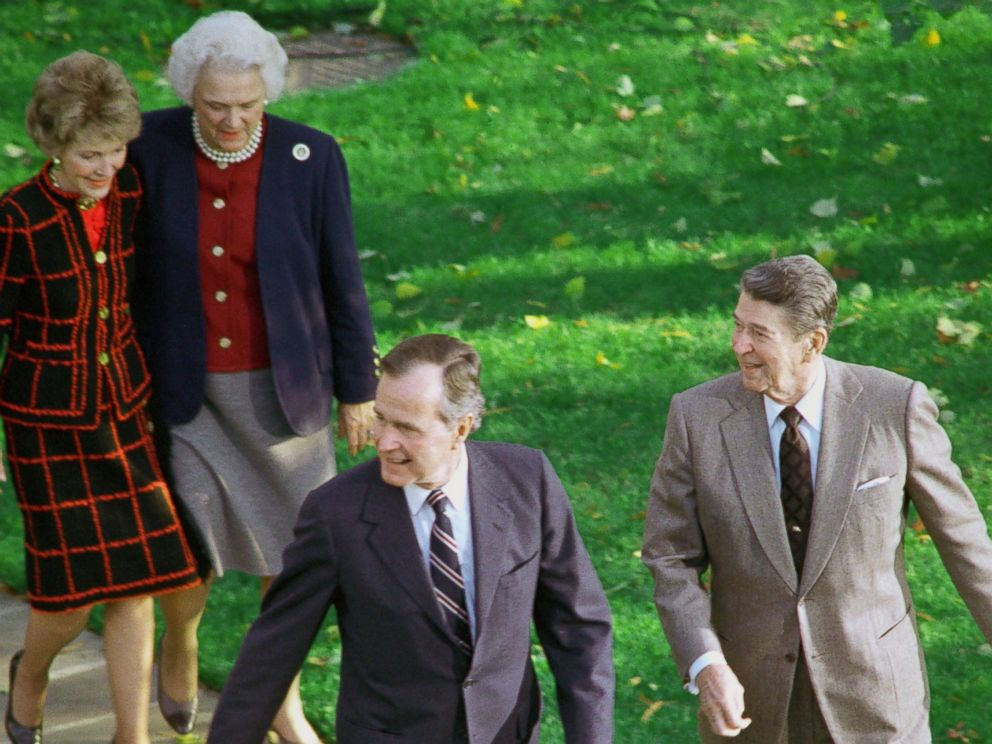PHOTO: President Ronald Reagan with President-elect George Bush, accompanied by their wives, Barbara Bush and Nancy Reagan, as they headed for the Oval Office November 9, 1988 after Bushs arrival at the White House.