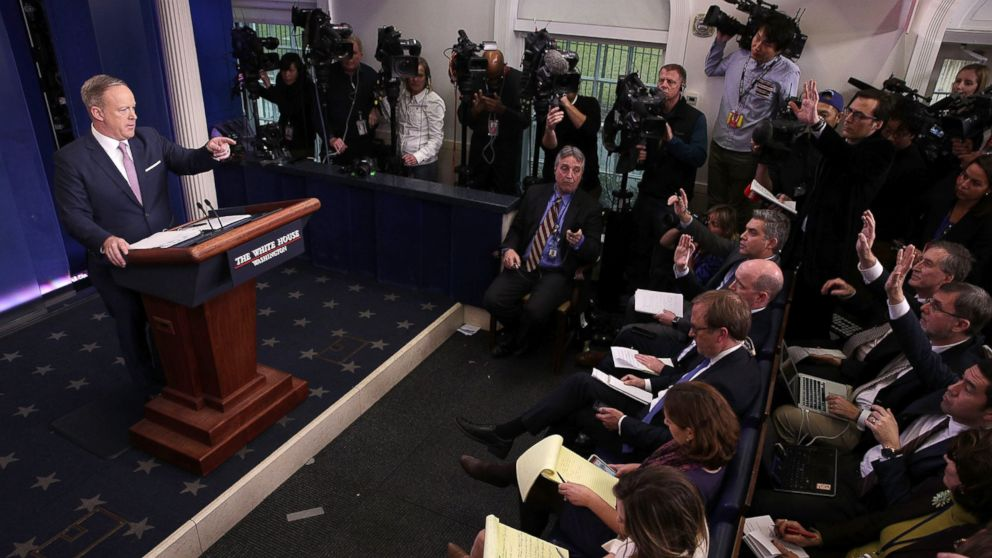 White House Press Secretary Sean Spicer (L) takes questions during a daily briefing at the James Brady Press Briefing Room of the White House January 23, 2017 in Washington.