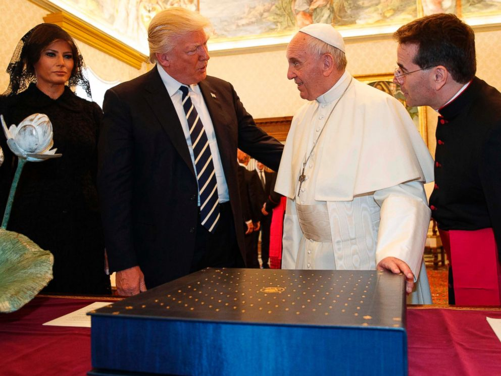 PHOTO: Pope Francis exchanges gifts with President Donald Trump and First Lady Melania Trump during a private audience at the Vatican on May 24, 2017. President Trump met Pope Francis at the Vatican today in their first face-to-face encounter.
