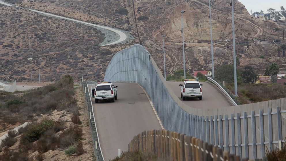 Border Patrol agents patroling the United States-Mexico Border wall during Opening the Door Of Hope/Abriendo La Puerta De La Esparana, at Friendship Park in San Ysidro, Calif., on Nov. 19, 2016.