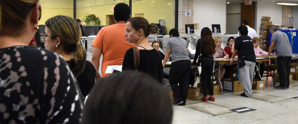 PHOTO: People line up to vote at an early voting polling centre in Miami, Florida on Nov. 3, 2016.