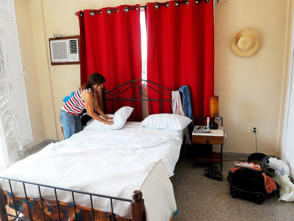 PHOTO: A Cuban woman tidies up the bedroom for tourists in a rental house in Havana, July 10, 2015.