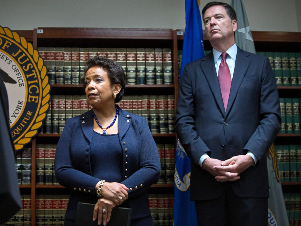 PHOTO: James Comey, director of the Federal Bureau of Investigation (FBI), right, and Loretta Lynch, U.S. attorney general, listen during a news conference, May 27, 2015.