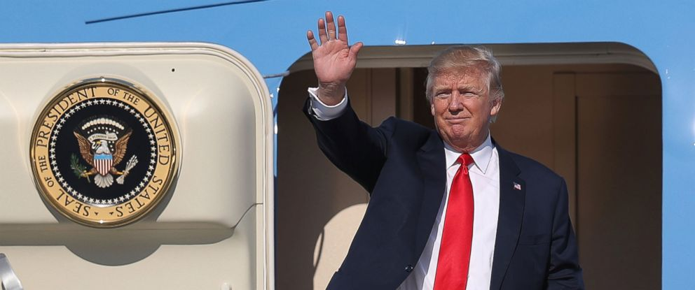 PHOTO: President Donald Trump waves as he arrives on Air Force One at the Palm Beach International Airport to spend part of the weekend at Mar-a-Lago resort on Feb. 17, 2017 in West Palm Beach, Florida.