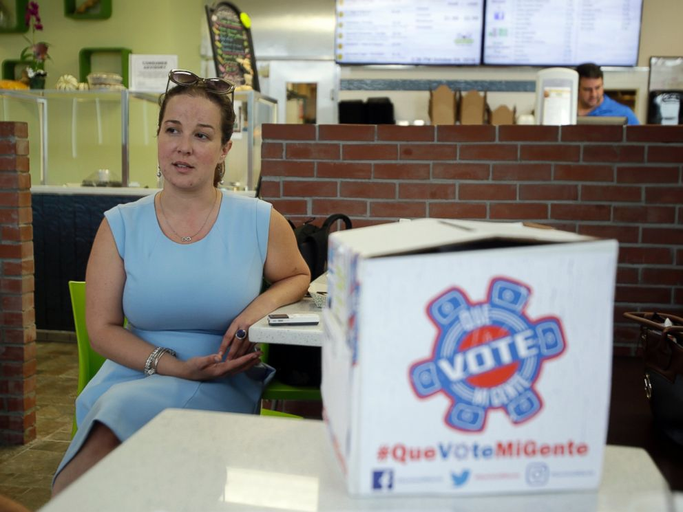 PHOTO: Christina Hernandez, an official with Organize Now, spends time at the Valisa Bakery to register voters in Orlando, Florida, Oct. 4, 2016.