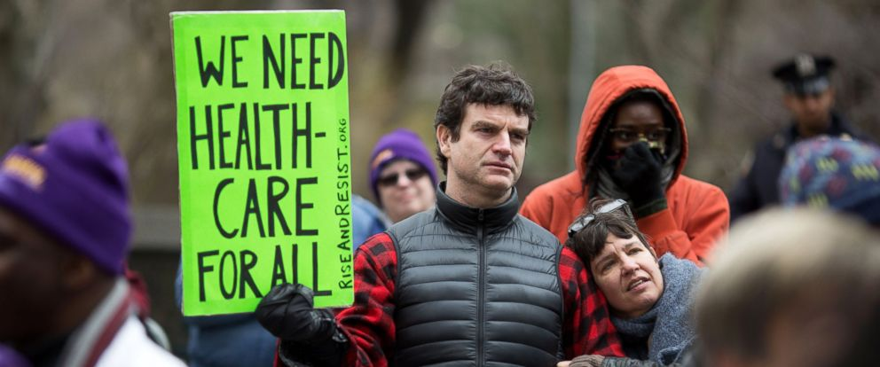 """PHOTO: Health care demonstrators promote the Affordable Care Act during a rally as part of the national """"March for Health"""" movement in front of Trump Tower, April 1, 2017, in New York."""