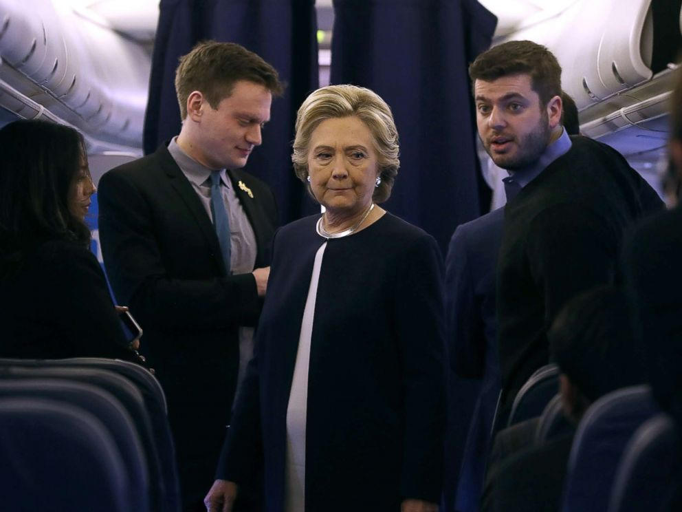 PHOTO: Democratic presidential nominee former Secretary of State Hillary Clinton talks with members of her staff aboard her campaign plane at Westchester County Airport, Nov. 4, 2016 in White Plains, New York.
