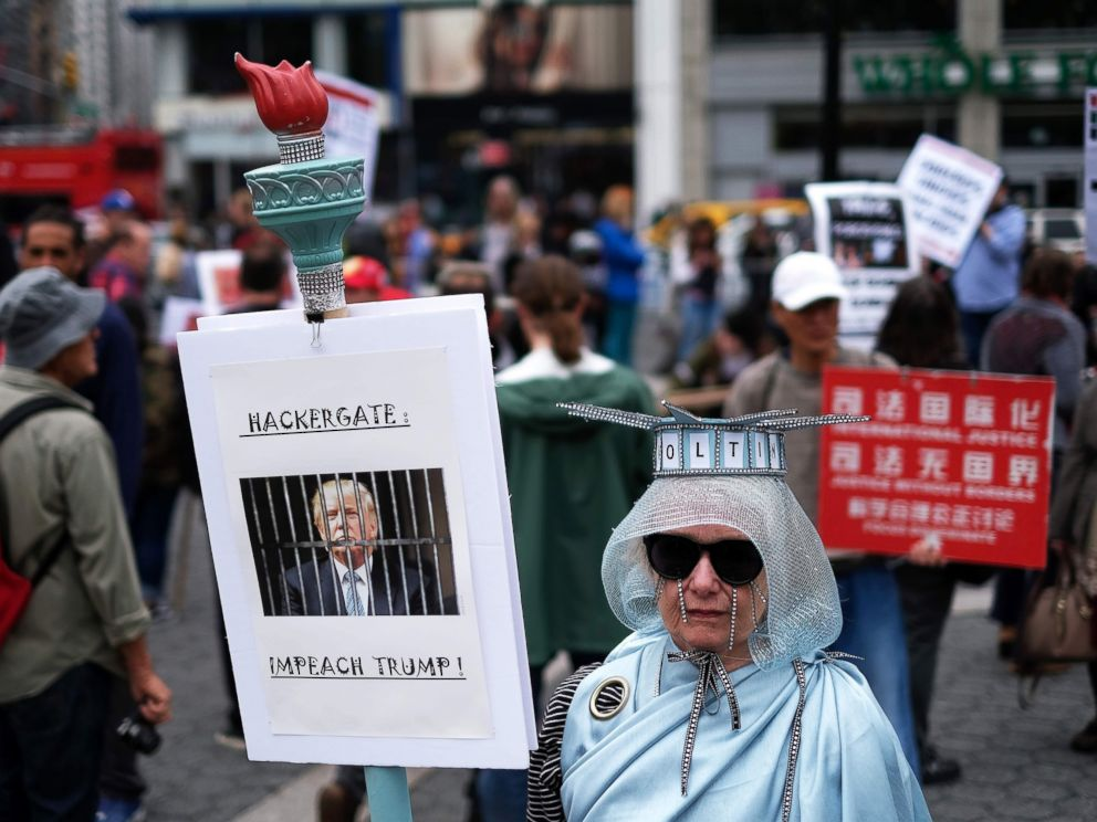 PHOTO: A protester displays a placard against President Donald Trump during a demonstration to mark May Day in New York, May 1, 2017.