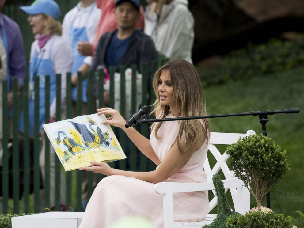 PHOTO: First lady Melania Trump reads a book during the 139th White House Easter Egg Roll on the South Lawn of the White House in Washington, April 17, 2017.