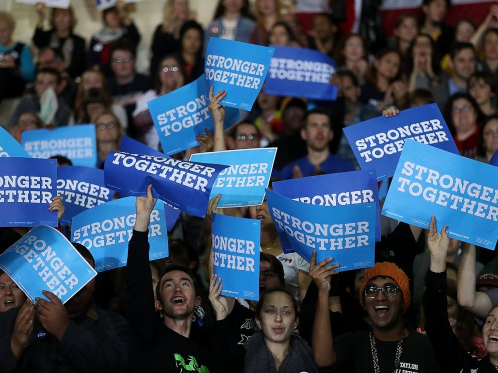 PHOTO: Supporters hold signs as democratic presidential nominee former Secretary of State Hillary Clinton speaks during a campaign rally at Taylor Allderdice High School, Oct. 22, 2016 in Pittsburgh, Pennsylvania.