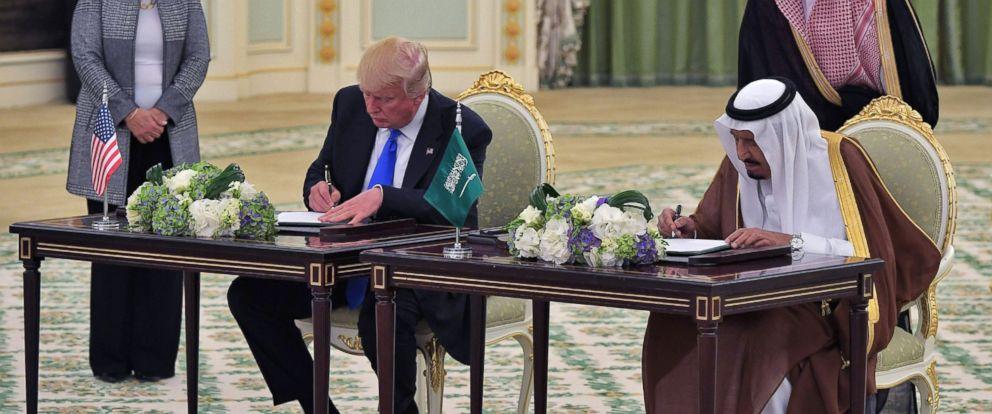 PHOTO: President Donald Trump (L) and Saudi Arabias King Salman bin Abdulaziz al-Saud take part in a signing ceremony at the Saudi Royal Court in Riyadh, May 20, 2017.
