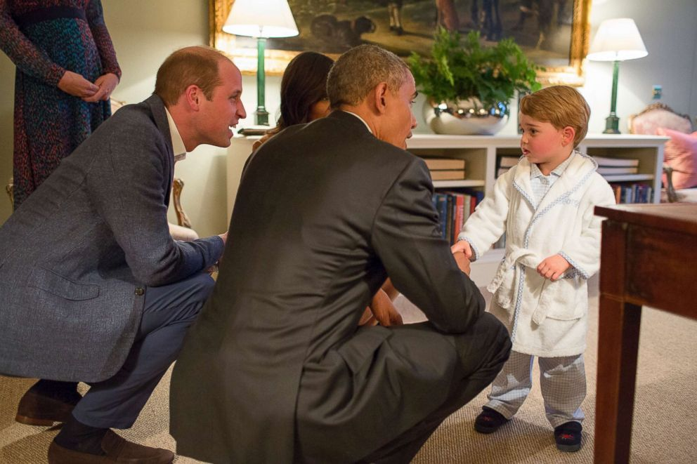 PHOTO: In this White House handout photo, President Barack Obama, Prince William, Duke of Cambridge and First Lady Michelle Obama talk with Prince George at Kensington Palace on April 22, 2016 in London.