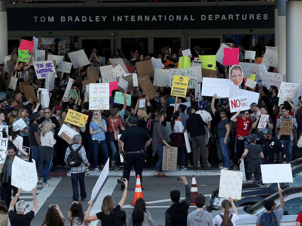 PHOTO: Protesters hold signs during a demonstration against the immigration ban that was imposed by U.S. President Donald Trump at Los Angeles International Airport, Jan. 29, 2017.