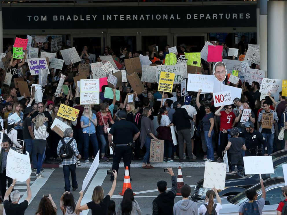 PHOTO: Protesters hold signs during a demonstration against the immigration ban at Los Angeles International Airport, Jan. 29, 2017.