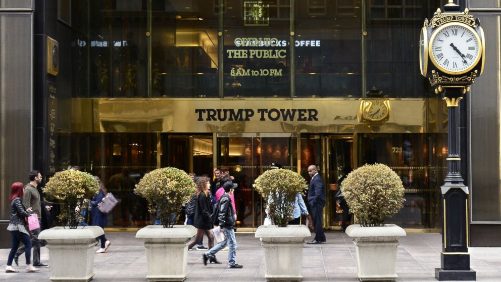 New York City shoppers and visitors walk past the entrance to Trump Tower on Fifth Avenue, a mixed use skyscraper owned by Donald Trump.