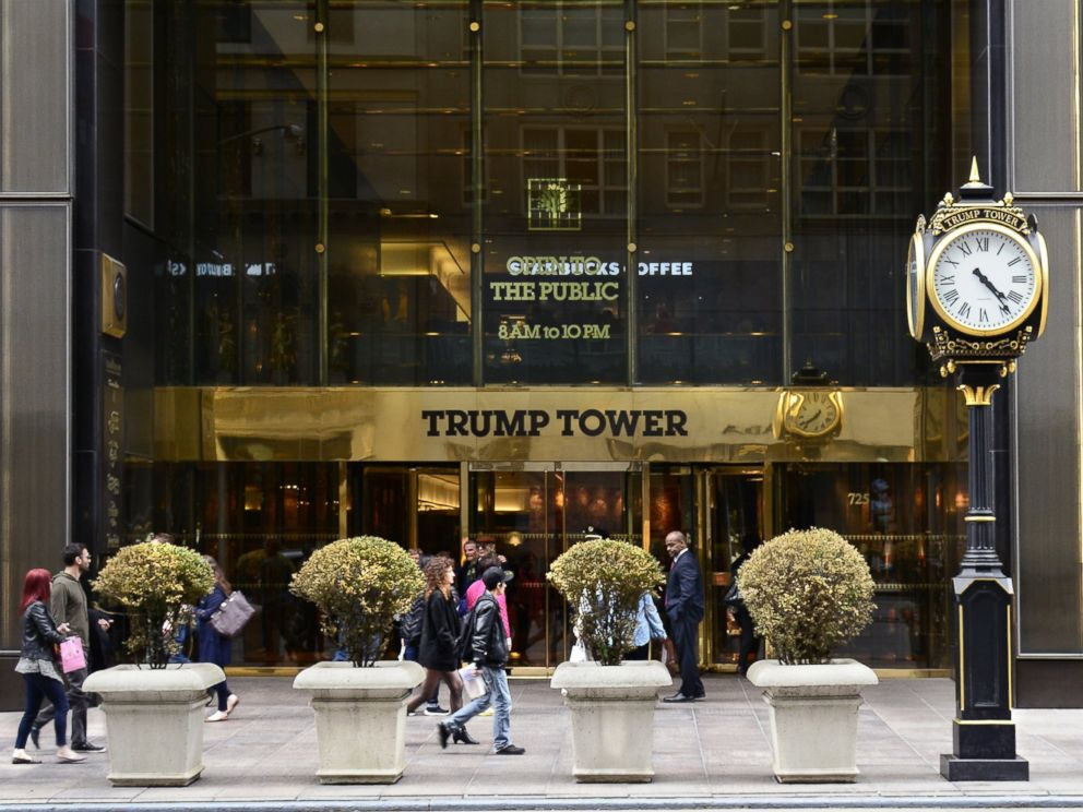 PHOTO: New York City shoppers and visitors walk past the entrance to Trump Tower on Fifth Avenue, a mixed use skyscraper owned by Donald Trump.