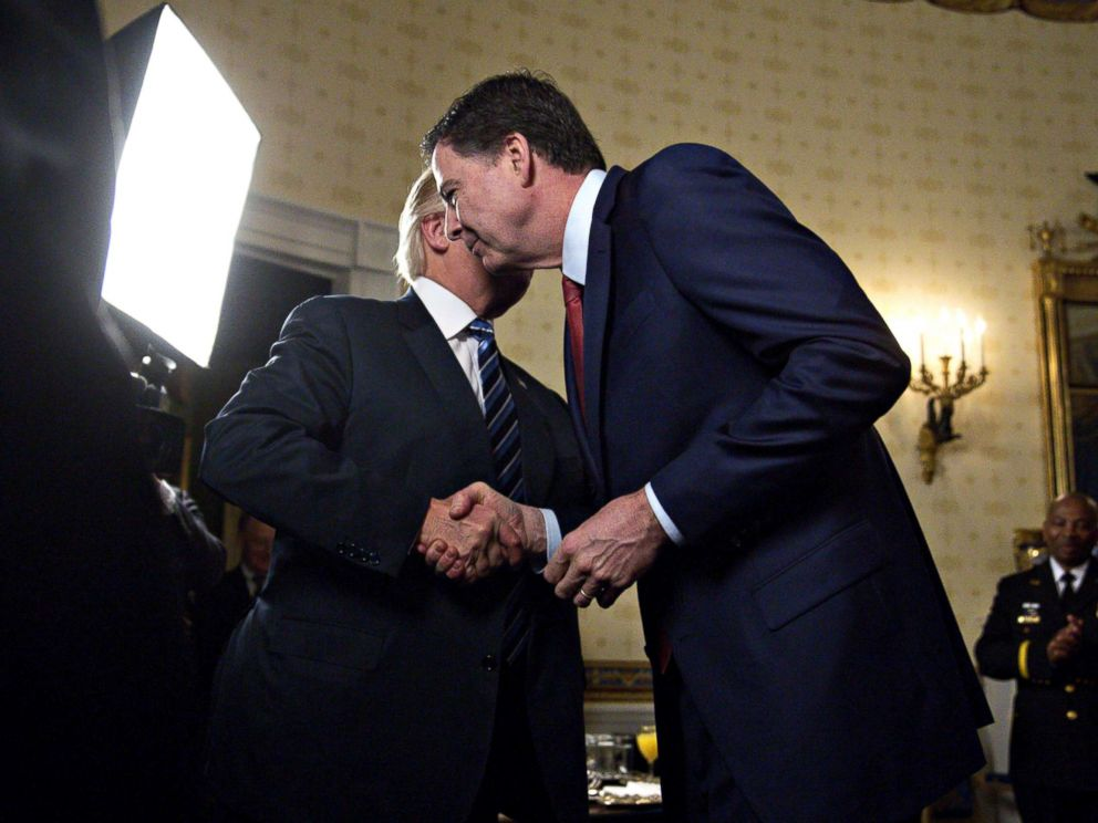 PHOTO: President Donald Trump, left, shakes hands with James Comey, director of the Federal Bureau of Investigation, during an Inaugural Law Enforcement Officers and First Responders Reception at the White House in Washington, Jan. 22, 2017.