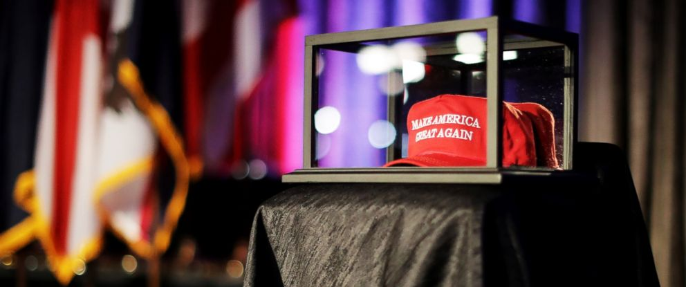 """PHOTO: A """"Make America Great Again"""" hat sits in a glass case during Republican presidential nominee Donald Trumps election night party at the New York Hilton Midtown, Nov. 8, 2016 in New York City."""