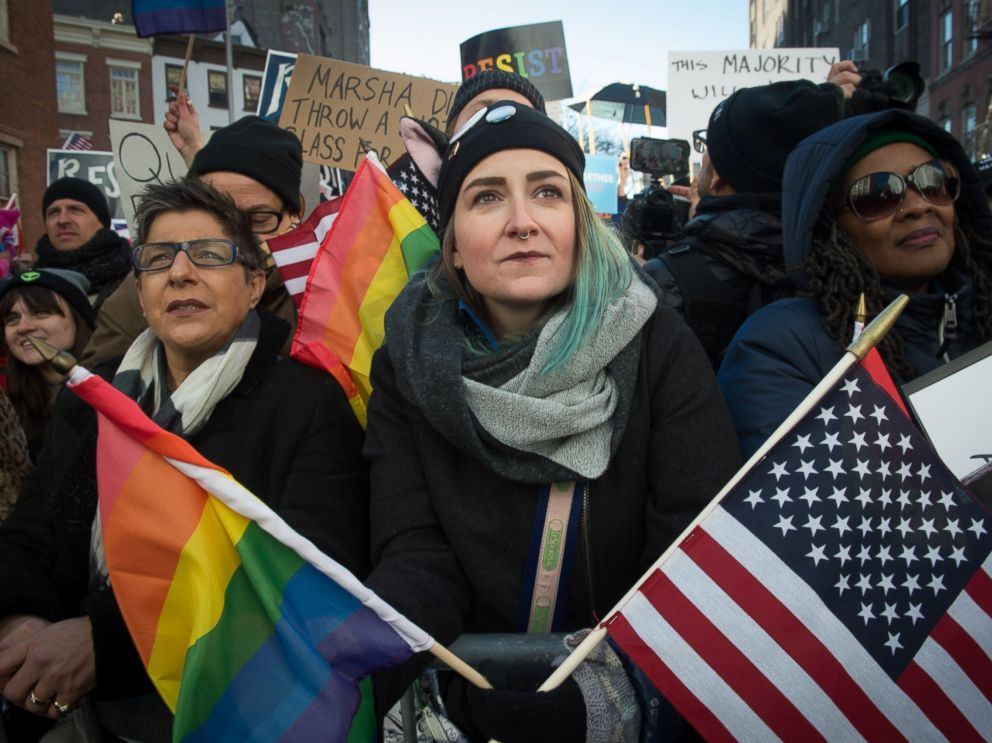 PHOTO: People hold signs and flags at a rally in front of the Stonewall Inn in solidarity with immigrants, asylum seekers, refugees, and the LGBT, Feb. 4, 2017 in New York.