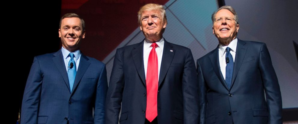 PHOTO: Donald Trump stands with National Rifle Association (NRA) President Wayne LaPierre and NRA-ILA Executive Director Chris Cox during the NRA Leadership Forum in Atlanta, Georgia, April 28, 2017.