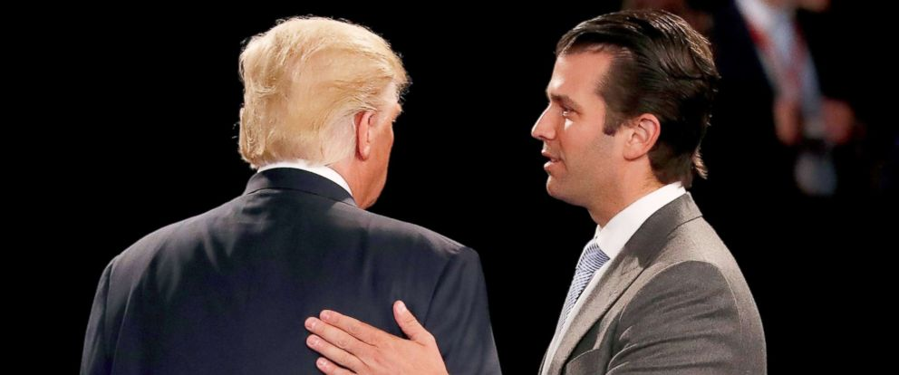 PHOTO: Donald Trump, Jr. greets his father, now President, Donald Trump during the town hall debate at Washington University, Oct. 9, 2016, in St Louis, Missouri.