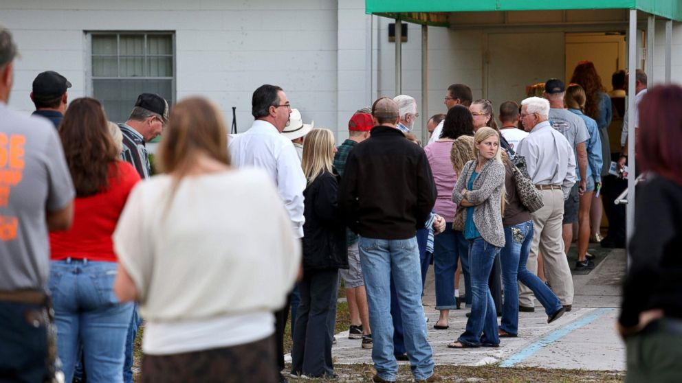 Voters wait in a queue to cast their ballots in the presidential election at a polling station in Christmas, Florida, Nov. 8, 2016.
